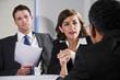 Businesswoman negotiating with men