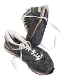Old grungy Running Shoes isolated