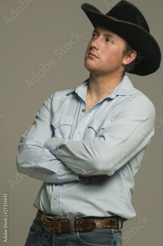 Young Man Wearing Western Wear With Arms Crossed