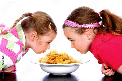 Children with Bowl of Crisps.Models Released