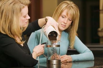 Woman Making Coffee In A French Press