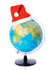 a christmas cap on the globe