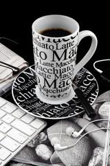 Coffee mug with fresh coffee on black background