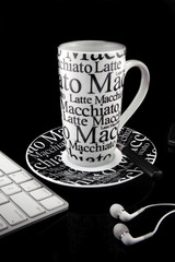 Coffee mug over black background