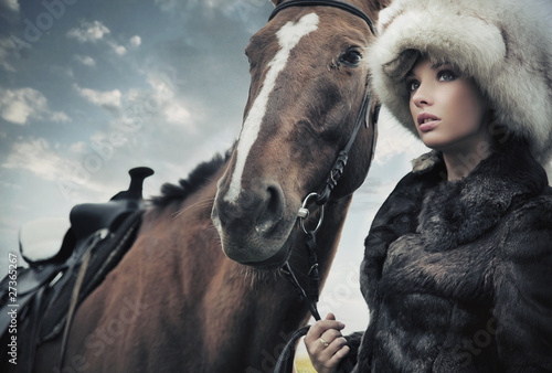 Cute woman with horse