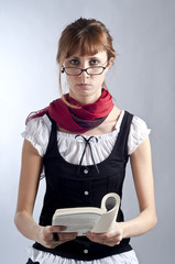 blonde girl with glasses, pen and book