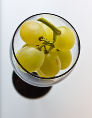 a glass of white grapes