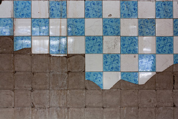 rough tile wall in abandoned building
