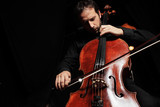 Cellist playing classical cello music on black background