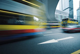 Long exposure photo of bus moving on road. Motion blur. poster