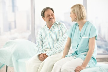 Older patient talking to nurse