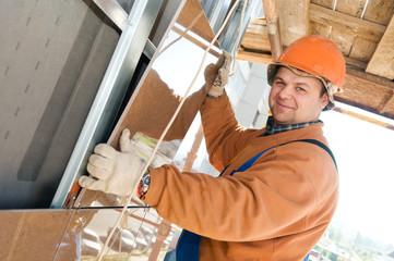 Worker builder at facade tile installation