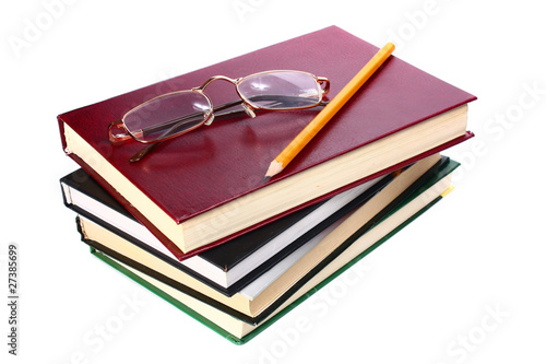 books is glasses and pencil