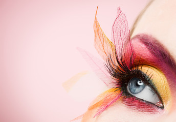 Blue eye with colorful make-up