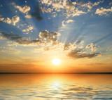 Fototapety sunset at coast of the sea