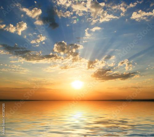 Leinwandbild Motiv sunset at coast of the sea