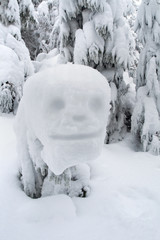 funny snowman handle in the Carpathian mountains
