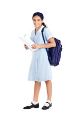 happy school student holding backpack and books