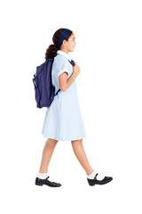 young school student walking to school on white