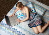 girl with laptop on the bed