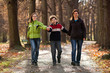 Active family - mother and kids walking outdoor
