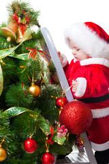 Baby decorating Christmas tree