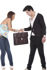 couple holding briefcase
