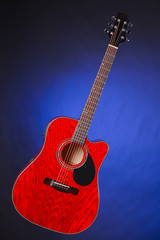 Acoustic Guitar Isolated on Blue