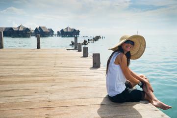 woman enjoying her vacation at the bay