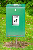 Close Up of Bright Green Dog Mess Poop Bin with Label