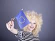 Beautiful girl with ringlets show European Union flag.