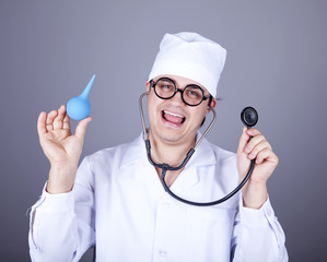 Crazy doctor with a stethoscope and enema.