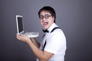 Men in suspender with bow tie and glasses keeping notebook.
