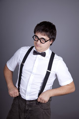 Portrait of funny fashion men in suspender with bow tie and glas