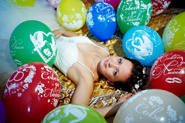 Beautiful bride and festive balloons