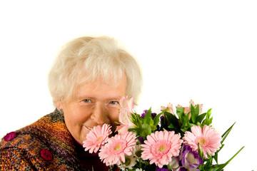 Rentnerin mit Blumenstrauss