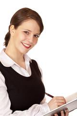 Lachende hübsche Frau notiert sich etwas in Ihren Terminplan