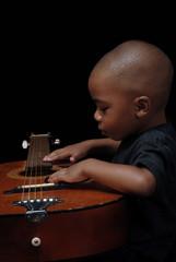african american boy play guitar
