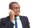 Young entrepreneur holding   while talking on cell phone poster