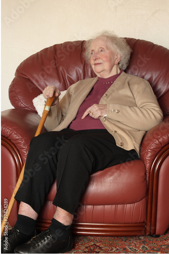 Elderly woman gazing into distance
