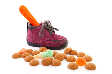 little children's shoe with carrot over white background