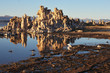 Tufa stalactites are reflected in lake