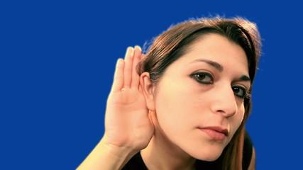 Blue screen beautiful girl try to hear