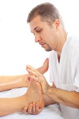 Orthopedist man massaging foot
