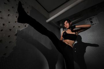 asian chinese mafia girl performing a kick