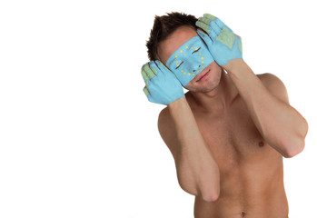 Young macho with painted face and hands