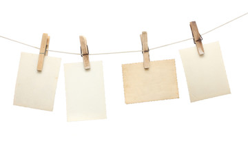 vintage photographs hang on the clothespin isolated