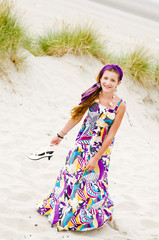 Model girl walking in sand dunes beach