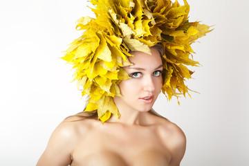 At the woman an autumn wreath on a head.