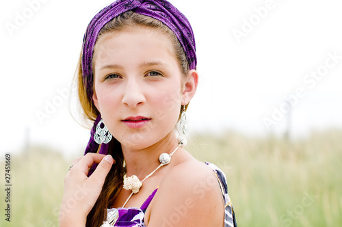Closeup of model girl on the beach